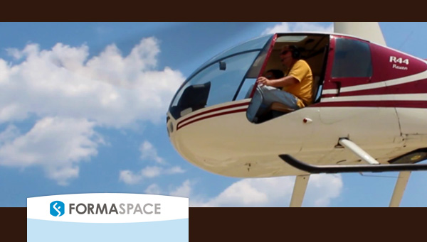 Is that an Amazon drone? Heck no, it's Team Formaspace — with Formaspace President Jeff Turk at the controls — in a demonstration flight that proves our industrial-strength workbenches are strong enough to support a full size helicopter.