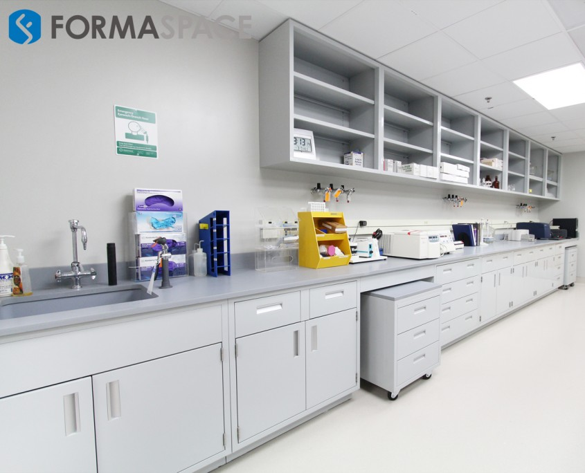Fort Sam laboratory with fixed casework and upper cabinetry