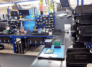 tech lab esd workbench assembly line with overhead lighting