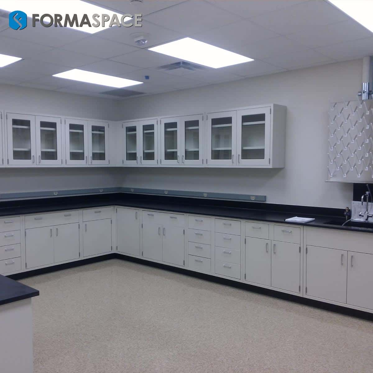 casework installment with pegboard and upper glass cabinets