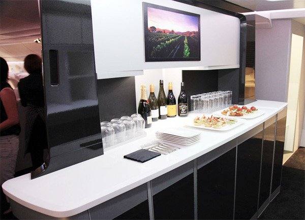 Many business travelers consider airplanes to be an extension of their office. A distinctive design element on Air New Zealand's new fleet of all-black Boeing 787-900s is the passenger cocktail bar. Its sleek black panels, separated by aluminum frames, are in keeping with the International Style.