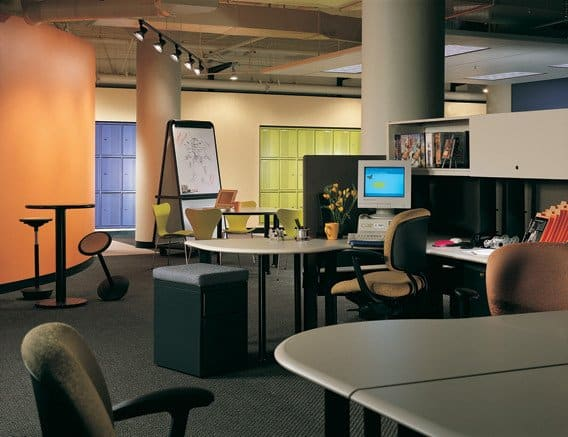"""Collaboration circa 1996 at Autodesk/Kinetix building in San Francisco at the beginning of the dot-com boom. Note blue and green lockers built into far wall for teleworkers coming into the office, and the """"rocker"""" bar stools which encourage impromptu meetings-- just don't linger too long. Architect HOK, interiors Millican/Jones."""